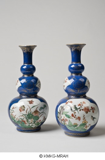 Bottle of triple gourd shape, decorated in powder blue, bird- and flower designs in reserved panels