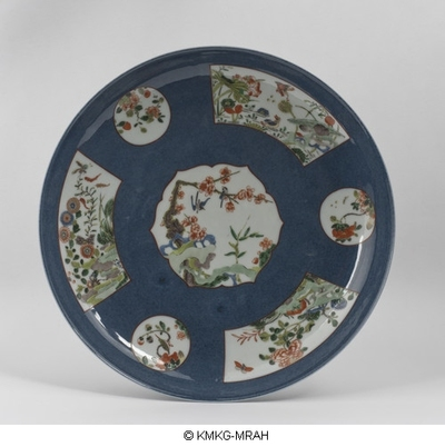 Large dish decorated in powderblue and reserved pannels decorated in famille verte