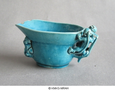 Libation cup with turquoise glaze, crawling dragons in high relief