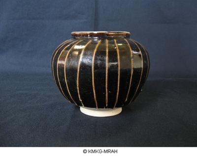 Small maroon vase decorated with rust coloured ribs