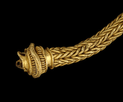 Image showing a close up of a terminal end of a gold Iron Age torc