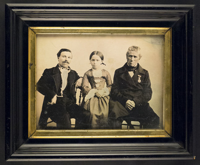 Portrait of two unknown men and a girl