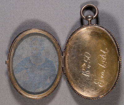 Portrait of young unknown woman, locket.