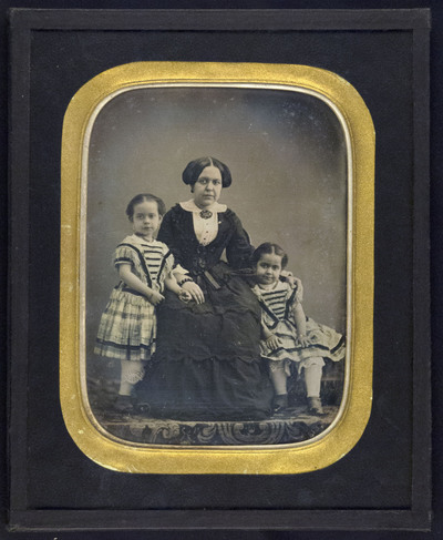 Portrait of an unknown woman and two girls