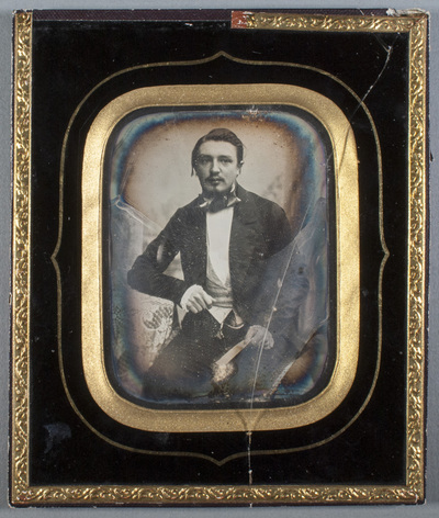 Portrait of unknown man with mustache.