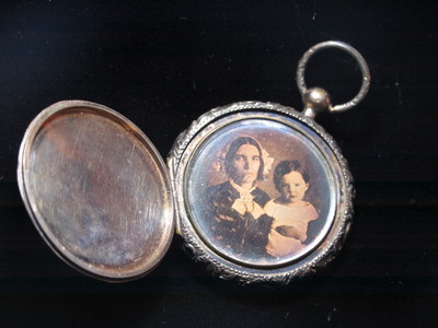 Watch case with two images on each side of the central post.