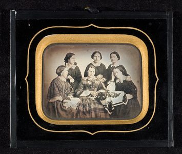 Group portrait of six young women, possibly a sewing circle or cousin circle.