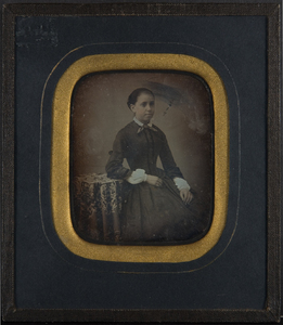 Portrait of a young girl with bow