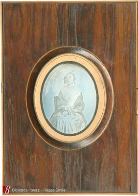 Plate is mounted in a wood frame like a miniature. Polishing lines are horizontal. Missing hanging hook. See BP_50201 for portrait of husband