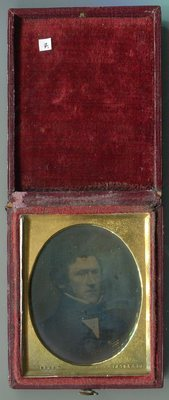 The plate is held in a plain tin tray stamped, possibly a pre_Thomas Wharton model