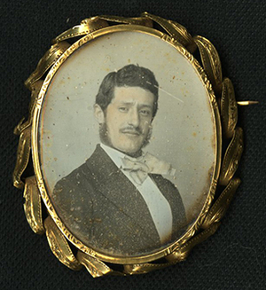Daguerreotype brooch with mother of pearl inlay  on other face.