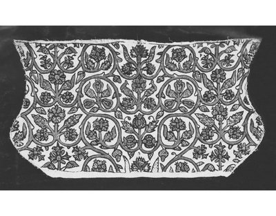 Woman's coif of linen, embroidered with blackwork, silver-gilt thread, flowers and fruits, 1575-1599, British. A linen coif embroidered with black silk in chain and back stitches, with silver-gilt thread in plaited-braid stitch. The pattern consists of scrolling stems outlined in black and filled with silver-gilt, bearing roses, honeysuckle, pomegranate, carnation, pansies, acorns, and pears, worked in black and embellished with silver-gilt. The individual motifs are filled with repeating geometrical patterns worked in back stitch. The outline of the coif is embroidered in black silk in stem stitch. The coif has cheek-pieces and a widow's peak and turned casing at the bottom. Remaining threads suggest that a lace border was once sewn to the front edges. The top seam and crown gathers have been unpicked at a later date.  Linen, linen thread, silk thread, silver-gilt thread; hand-sewn and hand-embroidered.