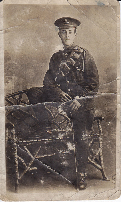 A very faded and torn photograph of Richard Broughton in full uniform